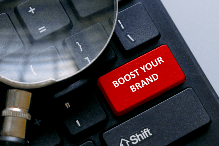 red button written with advice Boost your brand -GRINFER