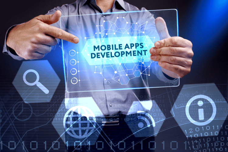 Businessman showing a word in a virtual tablet of the future - Mobile apps development