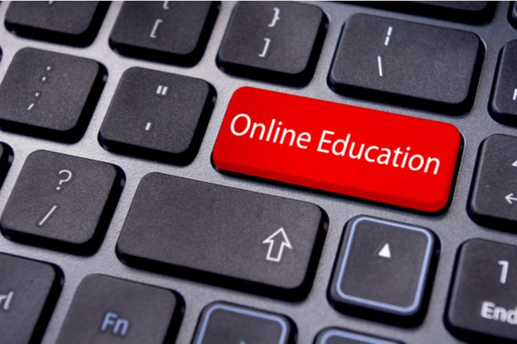 Concepts of online education, with message on enter key of keyboard GRINFER