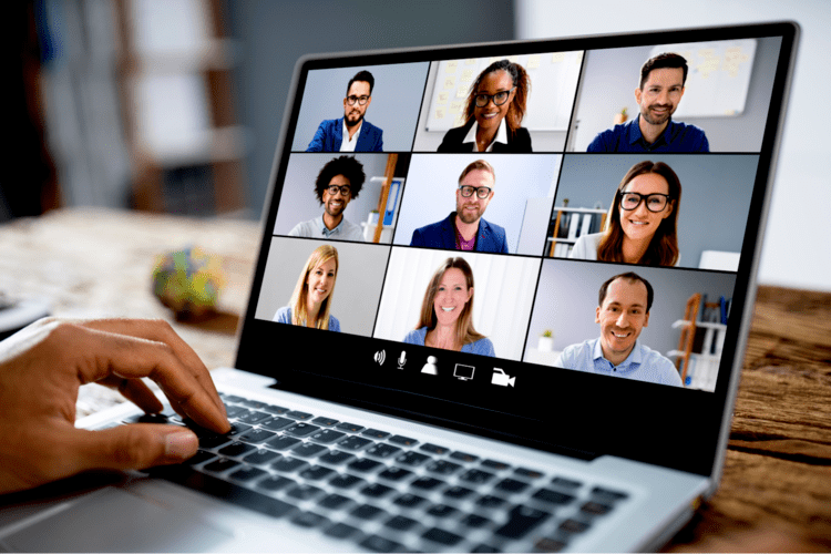Laptop screen with women's and men who take part in online course