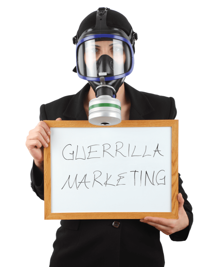 Girl in gas mask holding poster with text - Guerilla marketing