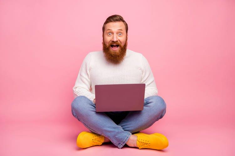 astonished guy freelancer entrepreneur work laptop