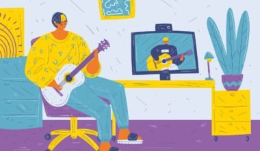 A young man sits in a room on an office chair with a guitar and have a video communication with a teacher