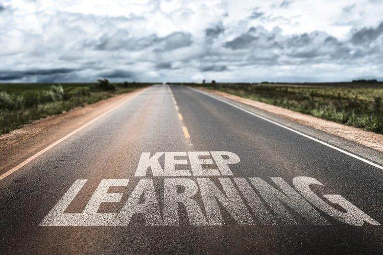 Keep Learning written on rural road